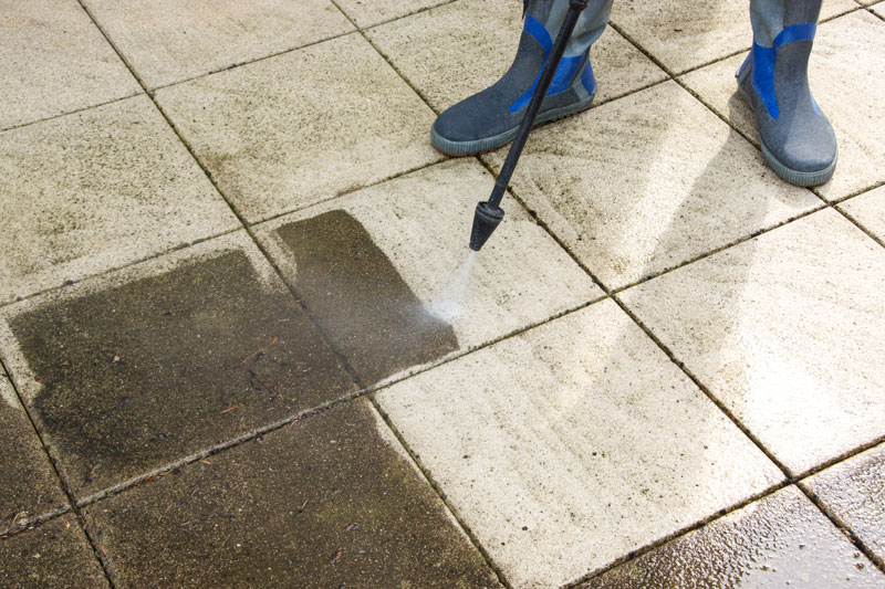 cleaning patio slabs with a pressure washer