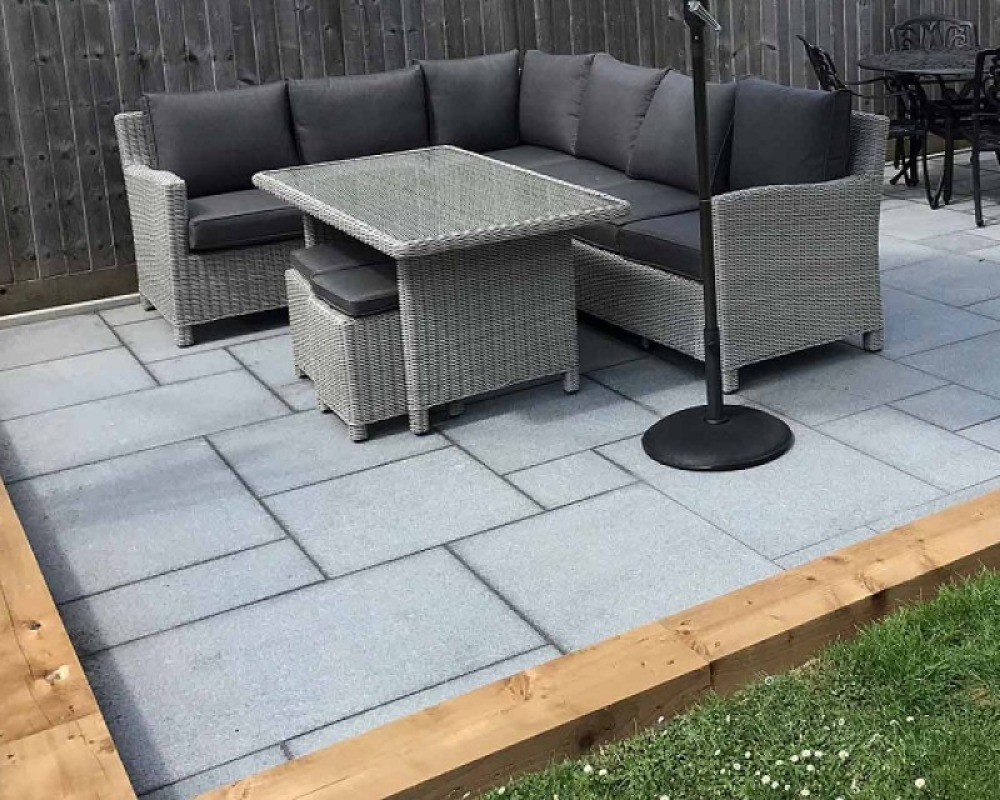 an image of a lovely garden with paving slabs and a sitting area